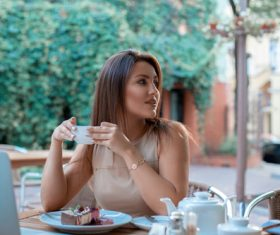 Girl looking back with a cup of coffee Stock Photo