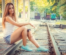 Girl sitting on the platform Stock Photo
