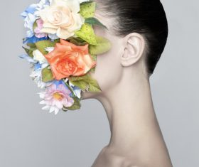 Girl wearing floral mask Stock Photo
