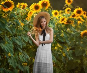 Girl wearing straw hat and sun flower Stock Photo