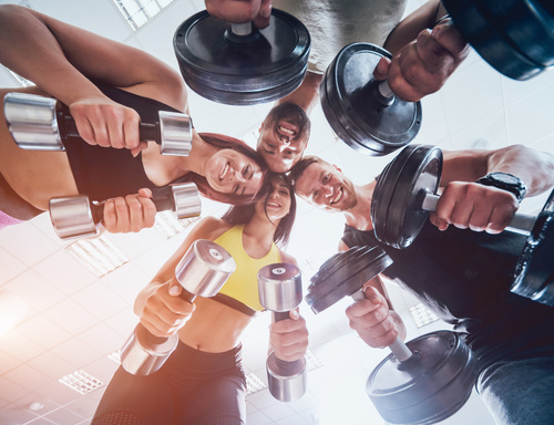 Group of athletic young peoples making exercise at the gym Stock Photo 02