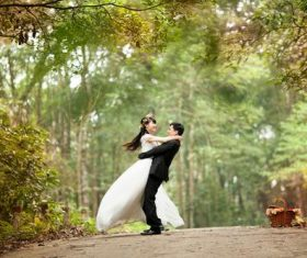 Happy couple shooting wedding photos Stock Photo