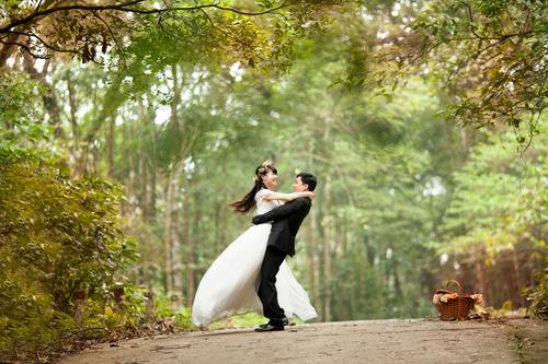 Happy couple shooting wedding photos Stock Photo
