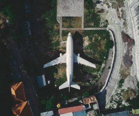 High angle shot white plane on the ground Stock Photo