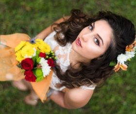 High angle shot woman holding flower Stock Photo