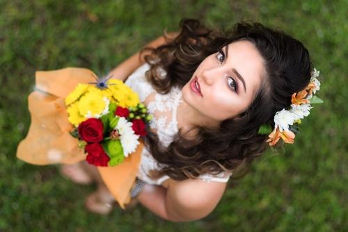 High angle shot woman holding flower Stock Photo
