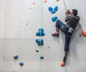 Indoor rock climbing fitness entertainment Stock Photo