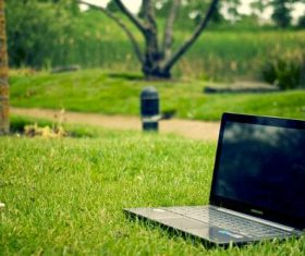 Laptop on the lawn Stock Photo