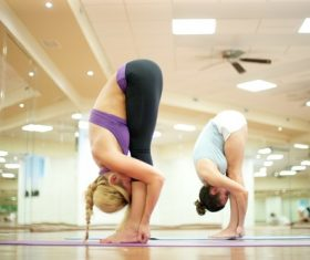 Learn yoga with yoga instructor Stock Photo