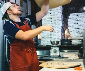 Male chef making pizza Stock Photo