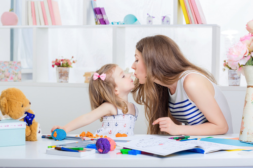 Mom and daughter interact closely Stock Photo