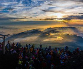 People watching the sunrise Stock Photo