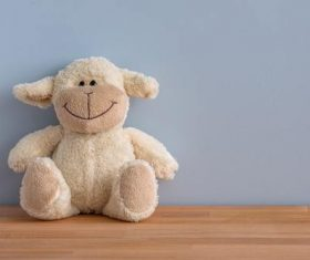 Plush teddy bear placed against wall Stock Photo