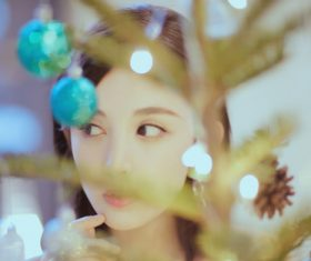 Pretty asian girl looking at christmas tree Stock Photo 03
