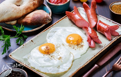 Sausage and fried egg Stock Photo