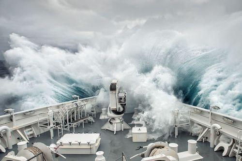 Ship in ocean storm Stock Photo