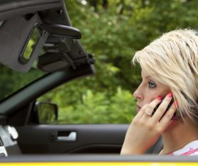 Short hair woman sitting in the car calling Stock Photo