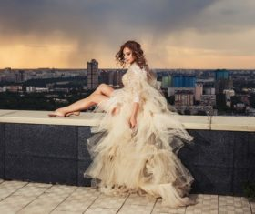 Sitting on the balcony of the roof photographing wedding woman Stock Photo
