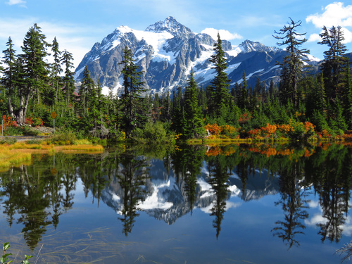 Snow mountain forest reflection in the lake Stock Photo