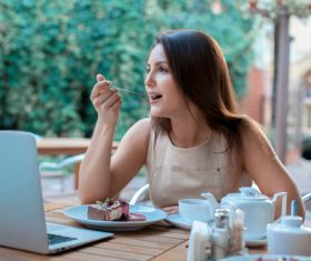 Stock Photo Woman eating cake
