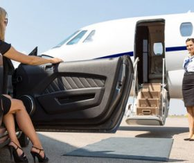 Stock Photo Woman getting off taking private plane