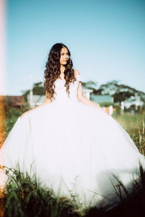 Stock Photo Woman in wedding dress posing