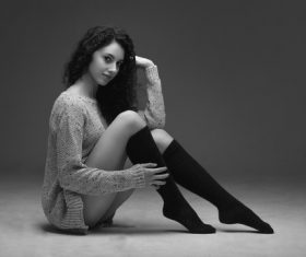 Stock Photo Woman wearing knit sweater and high knee socks