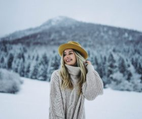 Stock Photo Woman wearing sweater and hat in winter outdoors