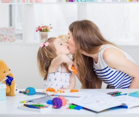 Stock Photo Young mother and daughter kiss