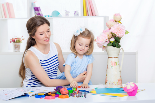 Stock Photo Young mother holding her daughter