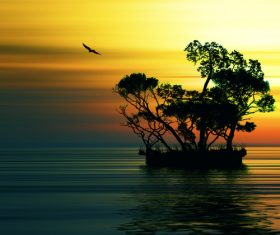 Sunset afterglow flying birds and small islands in the sea Stock Photo