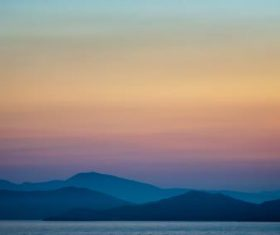 Sunset scenery of the distant mountains and the horizon Stock Photo