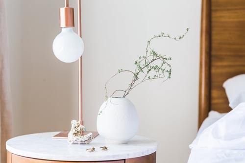Table lamp and green decoration in the room Stock Photo