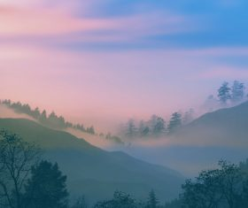 Thick fog shrouded the mountains Stock Photo