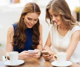 Two women keep each others phone number Stock Photo