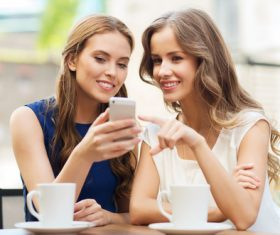 Two women looking at the phone Stock Photo