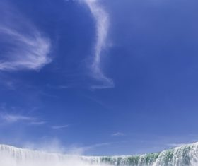 Waterfall & Blue Sky Stock Photo