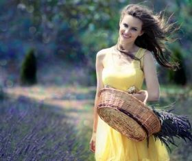 Woman holding a woven basket Stock Photo 01