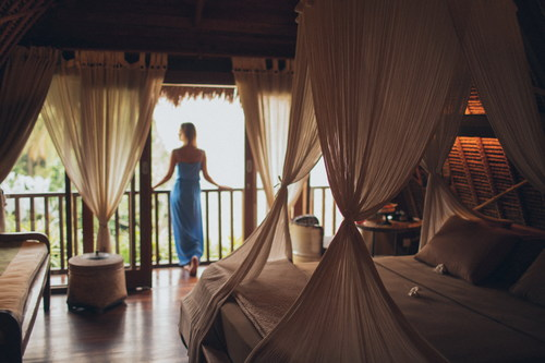 Woman in hotel bedroom Stock Photo