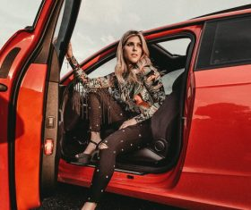 Woman opening the car door Stock Photo