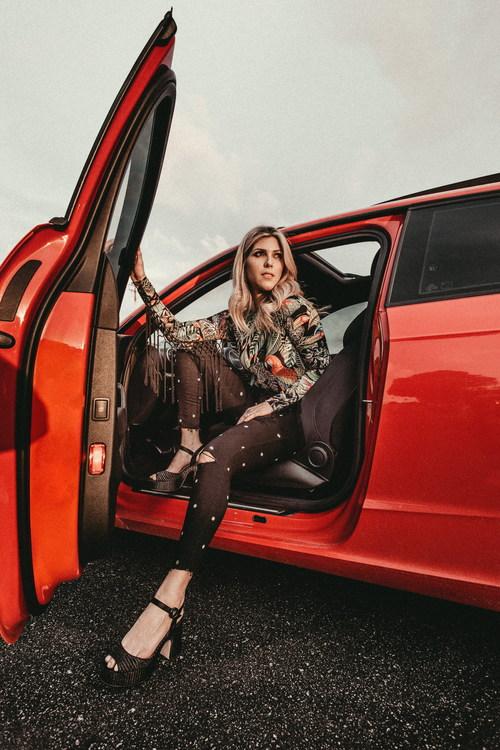 Woman opening the car door Stock Photo