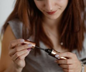 Woman painting eyeliner Stock Photo