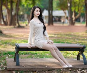 Woman posing on park bench Stock Photo