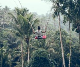 Woman swinging in scenic tourist area Stock Photo 04