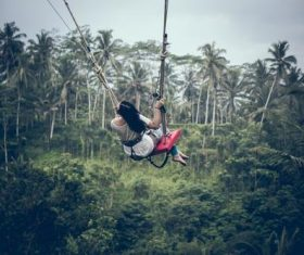 Woman swinging in scenic tourist area Stock Photo 05