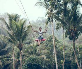 Woman swinging in scenic tourist area Stock Photo 06