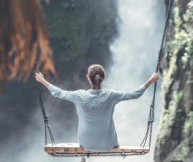 Woman swinging in scenic tourist area Stock Photo 07