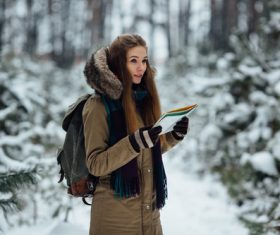 Woman traveling in winter field Stock Photo