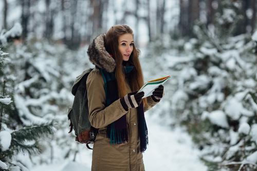 Woman traveling in winter field Stock Photo