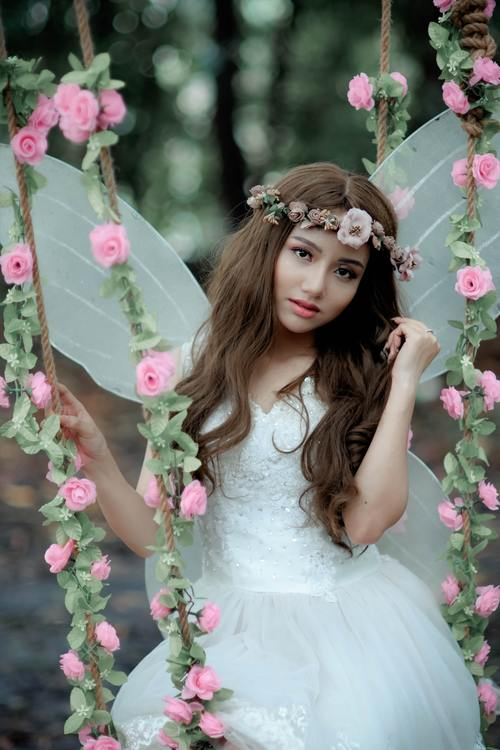 Woman wearing white gauze dress wearing wreath Stock Photo